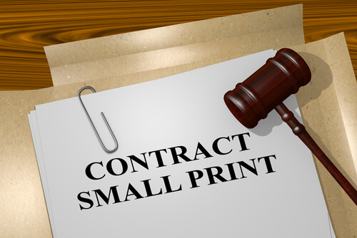 legal papers on a desk with the words contract small print