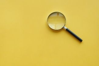 image of a magnifying glass on yellow background