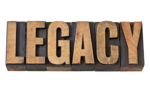 wooden blocks with capital letters spelling the word LEGACY