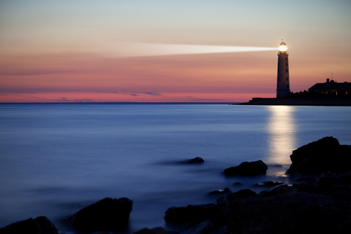 lighthouse with a beam of light guiding the way