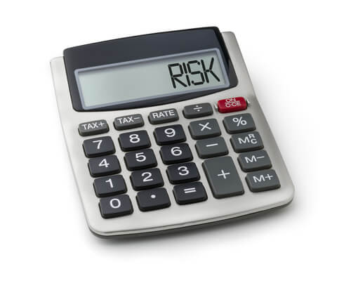 a desk calculator displaying the word RISK