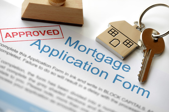 mortgage application form with the word approved stamped across the form