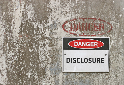A wall displaying a sign with the words Danger Disclosure